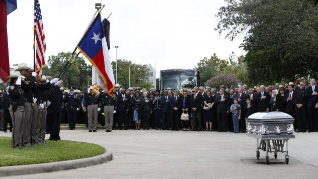 Mourners stand near the casket of Harris County Sheriff's Deputy Darren Goforth at Second Baptist Church in Houston, Texas, on Friday. Two people who were with the deputy on the night he was killed told his family Friday that he wasn't alone when he died