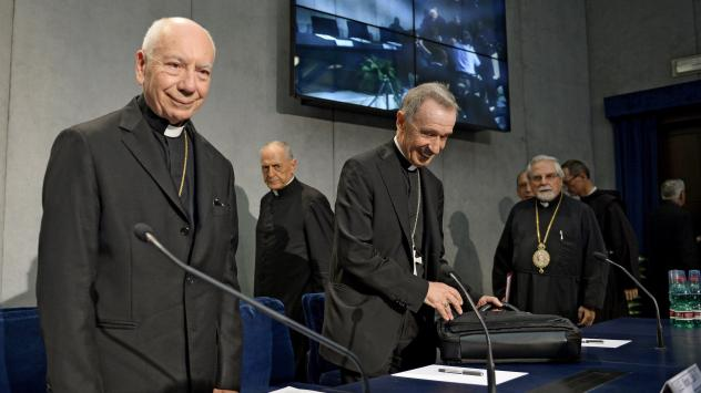 Cardinal Francesco Coccopalmerio (left), president of the Vatican Pontifical Council for Legislative Texts, arrives to read Pope Francis' statement on marriage annulment reforms at the Vatican on Tuesday.