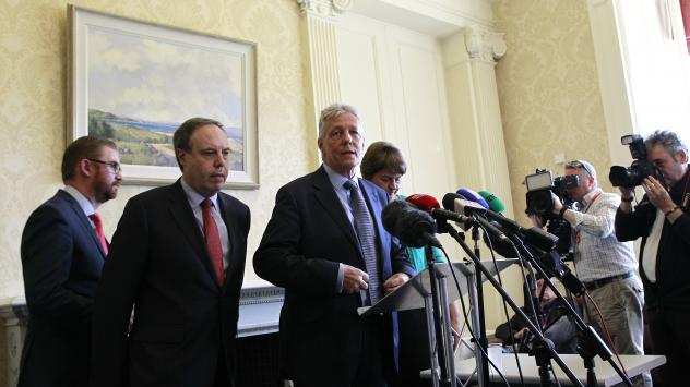 Peter Robinson (center) resigned as Northern Ireland's first minister, along with several other ministers from his party.