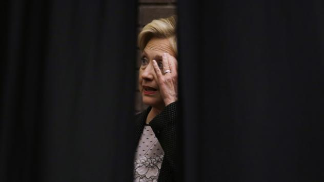Hillary Clinton waits behind a curtain before a rally at the University of Wisconsin-Milwaukee Thursday. She continues to struggle to explain her use of a private email server as secretary of state.
