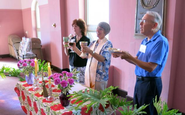 Rev. Caryl Johnson (center) oversees communion at St. Mary Magdalene Community in Drexel Hill, Pa., as parishioners Janet Hamm and Jim Kalb assist. Unlike most traditional Roman Catholic services, a gluten-free bread and alcohol-free wine are offered.