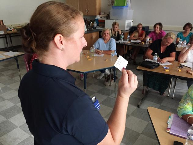 Katie Serio, director of treatment and prevention at the Council on Alcohol and Substance Abuse of Livingston County, N.Y., trains a group of school nurses to use the overdose antidote naloxone at Dansville High School.