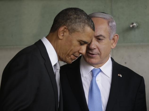 President Obama listens to Israeli Prime Minister Benjamin Netanyahu during their March 22, 2013, visit to a Holocaust memorial in Jerusalem.