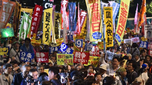 Demonstrators rally against Japanese Prime Minister Shinzo Abe's controversial security bills in front of the National Diet in Tokyo in September. The bills, which passed, will allow Japan to send its troops overseas for the first time since World War II