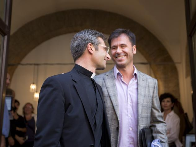 Monsignor Krzysztof Charamsa, left, and his partner Eduard, surname not given, leave a restaurant after a news conference in downtown Rome, on Saturday. The Vatican on Saturday fired Charamsa who came out as gay on the eve of a big meeting of the world's