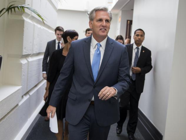 House Majority Leader Kevin McCarthy leaves a meeting on Capitol Hill on Thursday ahead of a nomination vote to replace outgoing House Speaker John Boehner.