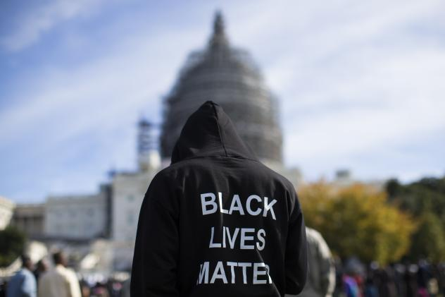 Neal Blair, of Augusta, Ga., stands on the lawn of the Capitol building during a rally to mark the 20th anniversary of the Million Man March, on Saturday.