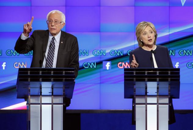 Hillary Rodham Clinton, right, and Sen. Bernie Sanders, of Vermont, speak during the CNN Democratic presidential debate on Tuesday.
