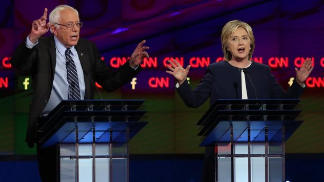 Democratic presidential candidates Sen. Bernie Sanders and Hillary Clinton on stage at the presidential debate Tuesday.