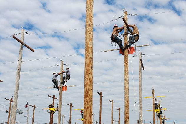 Linemen from across the country gather before the Lineman's Rodeo starts in Bonner Springs, Kan.