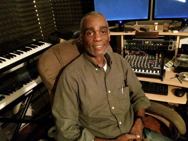 Vernon Thomas, a part-time music producer, is trying to decide whether it's worth it to sign up for health insurance.