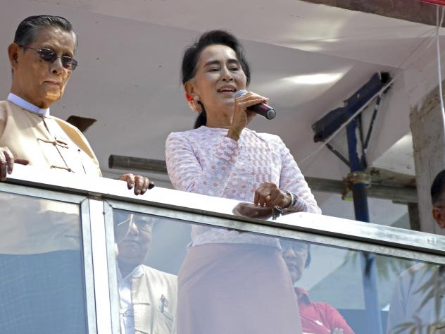 Myanmar's opposition leader Aung San Suu Kyi delivers a speech next to party patron Tin Oo (left) in Yangon, Myanmar, on Monday. Suu Kyi on Monday hinted that her party will win the country's historic elections, and urged supporters not to provoke their