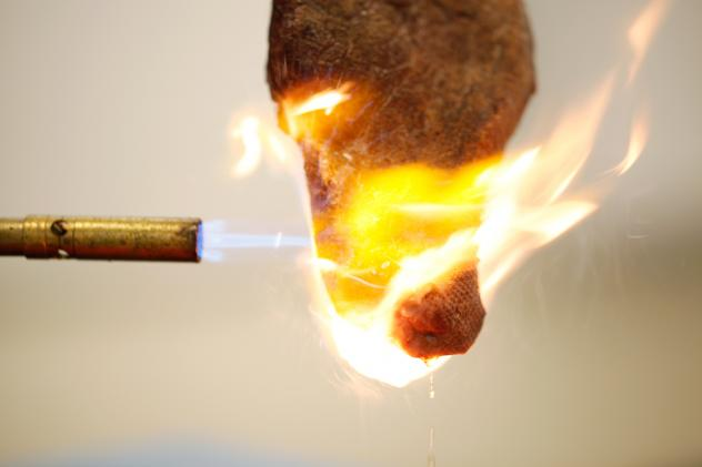 Matthew Hartings, a chemistry professor at American University, uses a blowtorch to demonstrate the Maillard reaction to his students. As the outside browns up, and the temperature heats up, lots of aroma and flavor compounds are created.