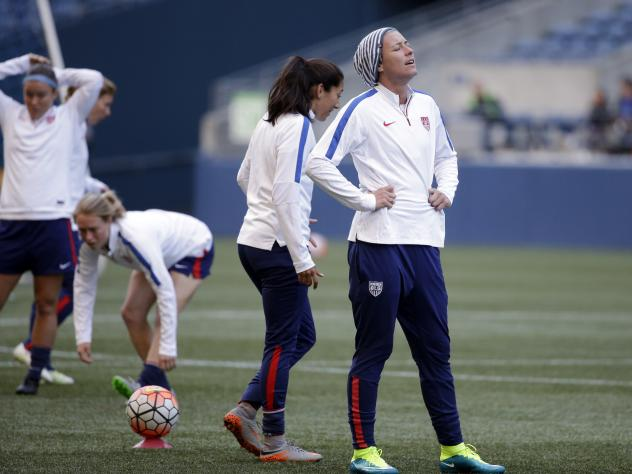 Abby Wambach of the U.S. women's national soccer team (right) stands with teammates during a practice in October. The team canceled a friendly match against Trinidad and Tobago on Sunday because of the poor state of the artificial turf.