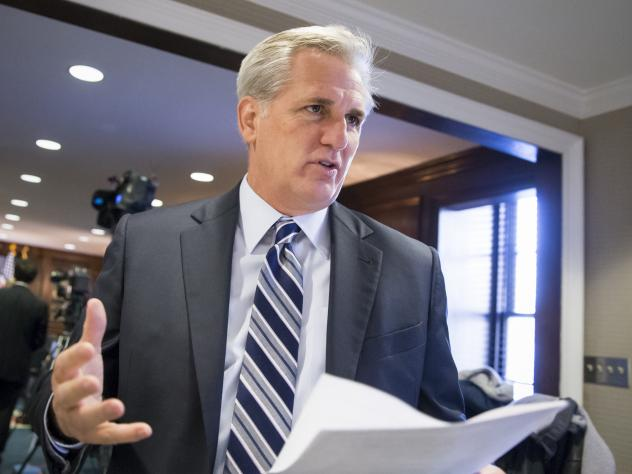 Majority Leader Kevin McCarthy, R-Calif., speaks with a reporter Tuesday before the House voted to tighten the program under which some foreign travelers enter the U.S. without visas.