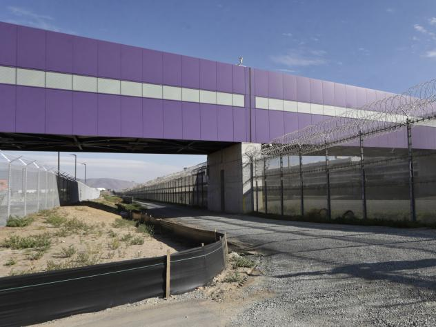 The walking bridge at the Cross Border Xpress air terminal in San Diego links the U.S. and Mexico. The terminal began operations on Wednesday, Dec. 9. (AP Photo/Lenny Ignelzi)
