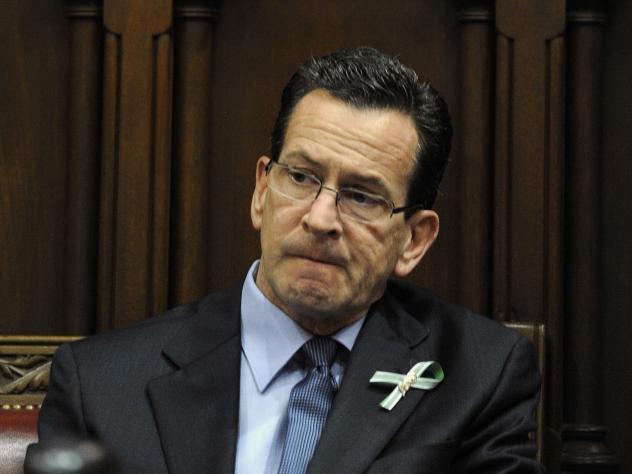 Connecticut Gov. Dannel Malloy listens to a memorial service for the victims of the Sandy Hook Elementary School shooting in December 2012.