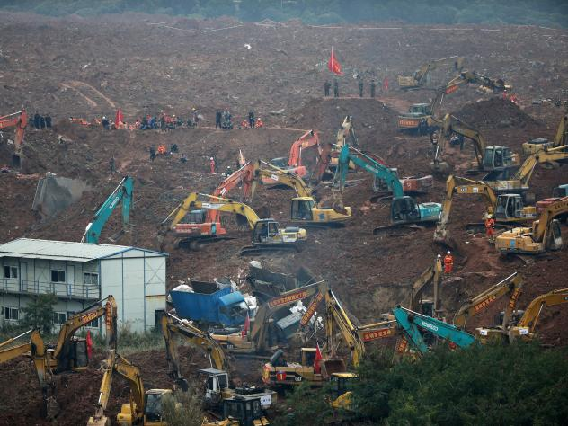 Rescuers use machinery to search for potential survivors following a landslide in the south of China.