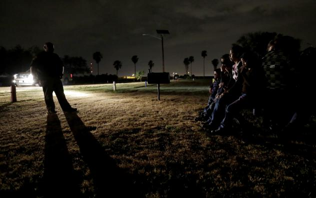Immigrants from Honduras and El Salvador who crossed the U.S.-Mexico border illegally are stopped by the Border Patrol in Granjeno, Texas.