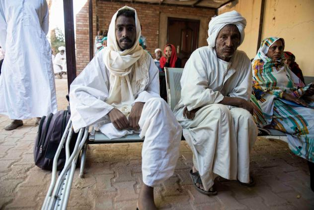 Mustafa Alnour Alhassan, 26, lost his leg to a flesh-eating fungal disease called mycetoma. Here, he sits beside his father, Albour Alhassan, at the Mycetoma Research Center in Khartoum, the capital of Sudan.