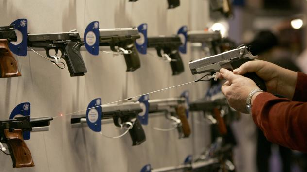 A federal rule requiring background checks doesn't apply to some of those doing business online and at gun shows, like this one put on by the National Rifle Association in April in St. Louis. Changing that exception is one idea that has been floated to t