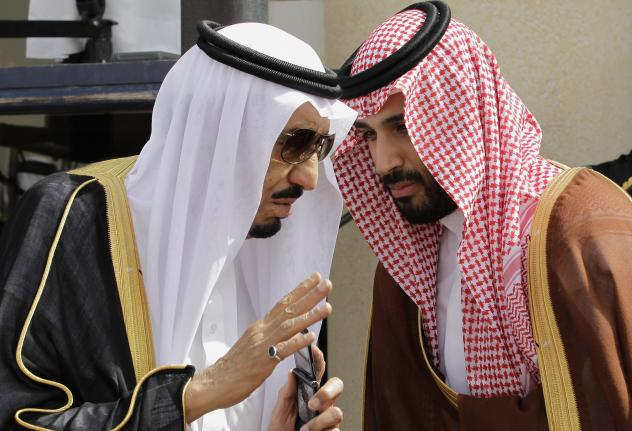 Saudi Arabia's King Salman (left) speaks with his son Mohammed in the capital Riyadh in 2012. The king was the crown prince at the time. When he assumed the throne last year, Salman named Mohammed, now 30, the deputy crown prince and defense minister. Th