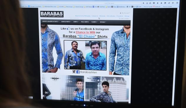 "A woman looks at the home page of the clothing house Barabas on Tuesday. At the time, the site featured two photos of Mexican drug kingpin Joaquin ""El Chapo"" Guzmán. Today the site shows a different ad — one that, again, stars El Chapo."