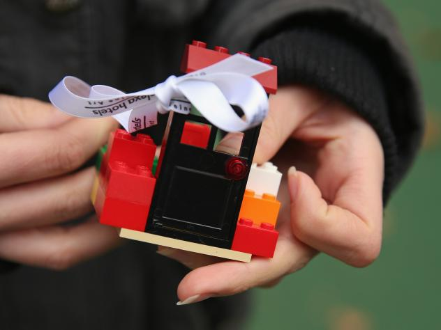 Passerby Lena Lauschuss prepares to donate Lego pieces for Chinese artist Ai Weiwei in Berlin in October.