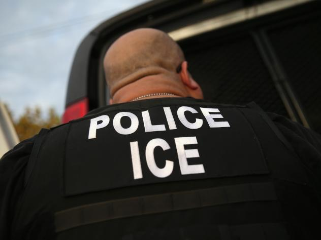 A U.S. Immigration and Customs Enforcement agent detains an immigrant in October 2015. Though the Department of Homeland Security says it is looking for recent arrivals, criminals and people with deportation orders, that hasn't reassured immigrants like