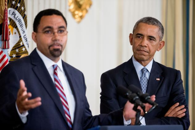 Acting Education Secretary John King Jr., left, accompanied by President Barack Obama, at the White House in Washington.