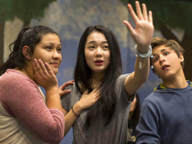 Seventeen-year-old Amber Zhang learns to play drums from freshman Ashley Li at Arroyo Pacific Academy in Arcadia.