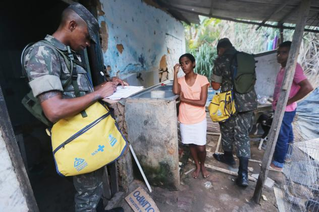 Brazilian soldiers go house-to-house as they attempt to eradicate the larvae of the mosquito that causes the Zika virus.