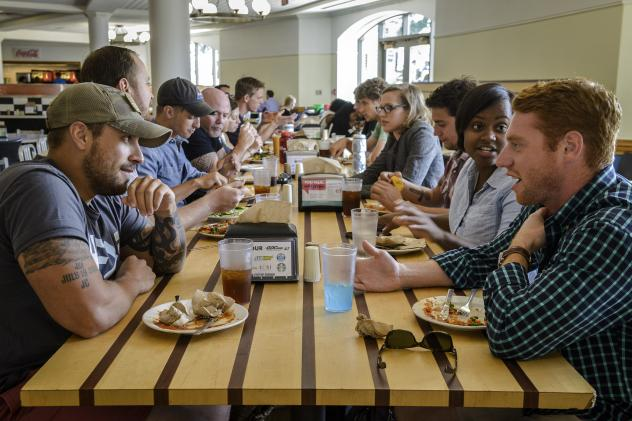 Participants in a Georgetown University program for military veterans dine together on campus in Washington, D.C.