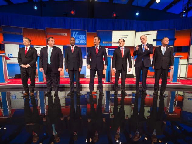 Republican Presidential candidates arrive for the final Republican Presidential debate before the Iowa caucus in Des Moines, Iowa on Thursday.