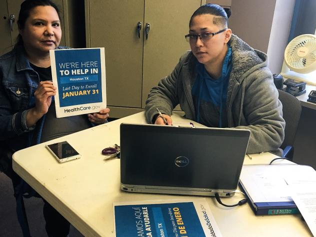 Iris Galvez, a health insurance navigator (right) helps Mary Soliz of Houston, Texas, sign up for her first health plan through the Affordable Care Act on January 28, 2015 at a Houston community center.
