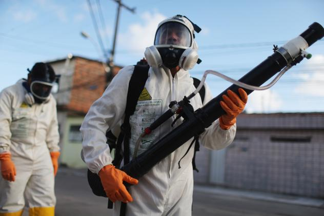 Health workers fumigate to wipe out mosquitoes in Recife, Brazil.