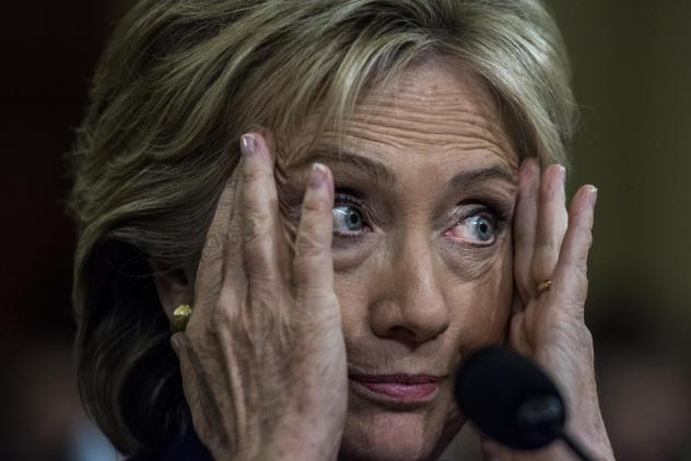 Former Secretary of State Hillary Clinton reacts to an argument between the chairman and co-chairman of the House Select Committee on Benghazi during her testimony at a hearing last year.