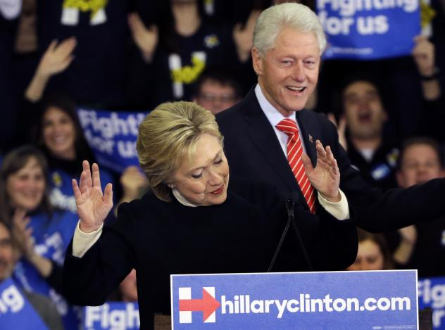 Democratic presidential candidate Hillary Clinton reacts as former President Bill Clinton smiles at a presidential primary campaign rally in Hooksett, N.H.