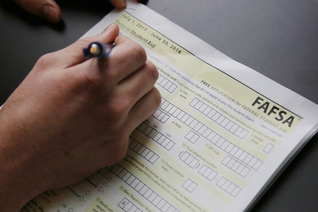 High school students fill out financial aid forms and are able to submit them as early as October.