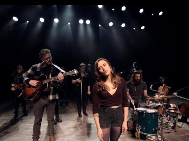 "The Ballroom Thieves, with members of the Maine Youth Rock Orchestra, in a scene from the video for the song ""Bury Me Smiling."""