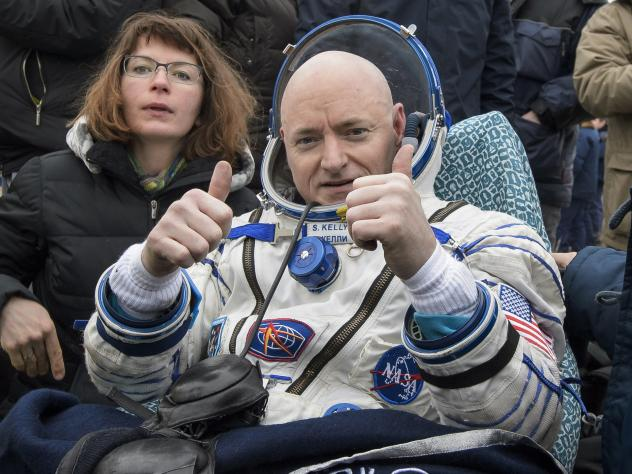 Astronaut Scott Kelly reacts after returning to Earth after nearly one year aboard the International Space Station.