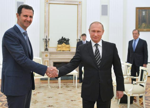 Russian President Vladimir Putin (right) hosts Syrian President Bashar Assad during a meeting at the Kremlin in Moscow. The meeting took place in October, shortly after Russia began a bombing campaign in Syria in support of Assad. Putin abruptly announce