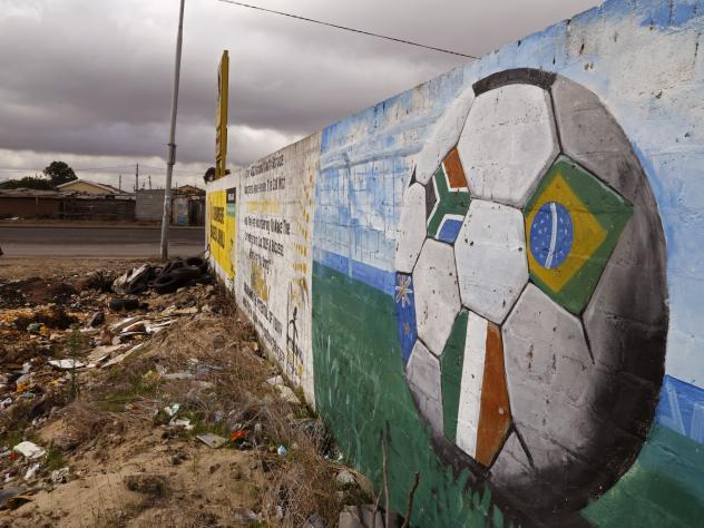 A soccer ball covered with flags is painted on a wall in the township of Khayelitsha, South Africa. The image of South Africa's 2010 World Cup has been shattered by allegations that its bid over a decade ago was boosted by bribes of more than $10 million