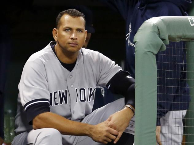 New York Yankees' Alex Rodriguez sits in the dugout during a game against the Boston Red Sox at Fenway Park in Boston in 2013.