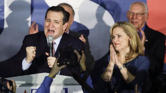 Republican presidential candidate, Sen. Ted Cruz, R-Texas, speaks during a caucus night rally as his wife Heidi listens in February in Des Moines, Iowa.