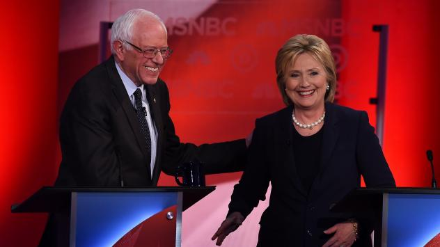 US Democratic presidential candidates Hillary Clinton (R) and Bernie Sanders smile after participating in the MSNBC Democratic Candidates Debate at the University of New Hampshire in Durham on February 4, 2016.
