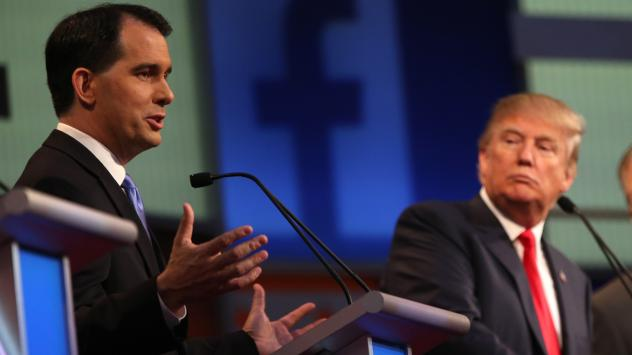 Republican presidential candidate Scott Walker speaks as Donald Trump, listens during the first Republican presidential debate in Cleveland last August.