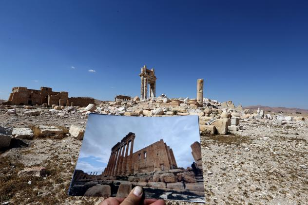 Pieces of beheaded and mutilated sculptures lie on the ground at the museum of the ancient city of Palmyra, Syria, on Thursday. Syrian troops with Russian support recaptured Palmyra last week, after a fierce offensive to retake the city from jihadists wh