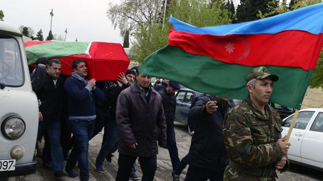 On Sunday, men carry the coffin of an Azerbaijani serviceman who was killed Saturday during clashes between Armenian and Azeri forces in the disputed region of Nagorno-Karabakh, which is controlled by Armenian separatists.