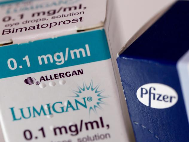 A box of Lumigan eye-drops, produced by Allergan Plc, stands next to a box of Viagra tablets, produced by Pfizer Inc. The Irish and American drugmakers were planning to merge, but the deal has been called off after a change in U.S. tax law reduced the po